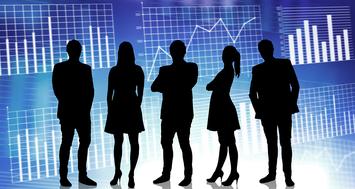 Five business people silhouetted with financial bar charts and line graphs behind them